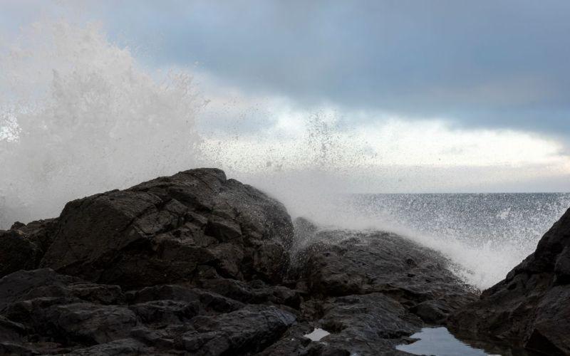 Wave splashing at Cox Bay tofino