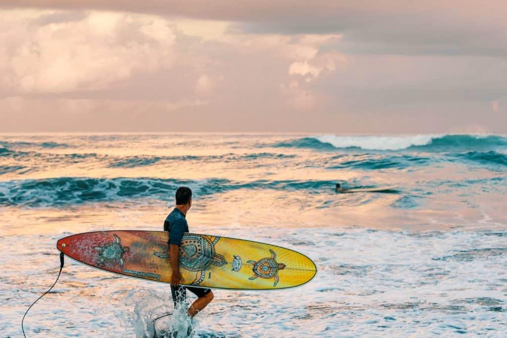 man with surfboard bali beach SP