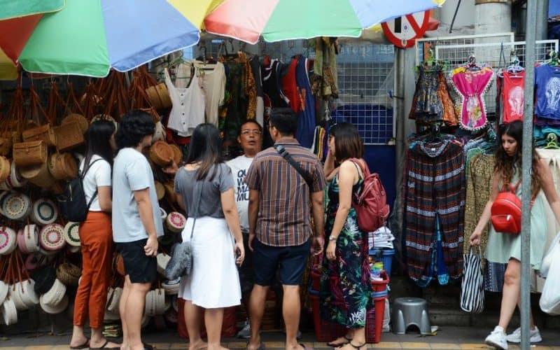 Tourist sightseeing at Ubud market in Bali