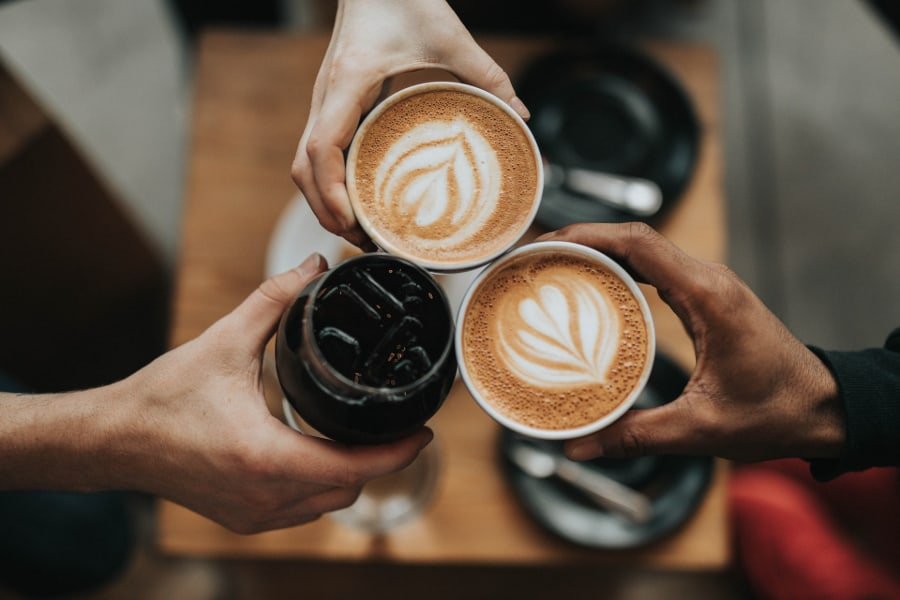 people holding coffee sp