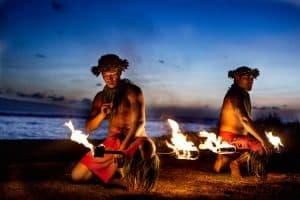 Two Hawaiian Men dancing with Fire at luau
